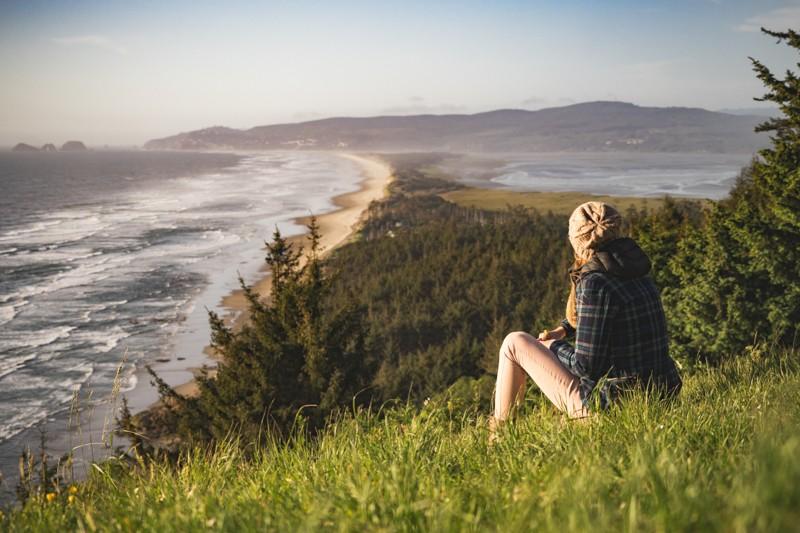 Woman overlooking Cape Lookout, Oregon Coast